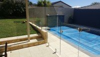 Lawn beside Frameless Pool Fence