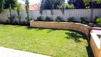 Lawn and Limestone Retaining Wall with Plants