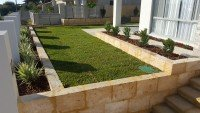 Reconstituted Limestone Blocks Wall and Turf Installation