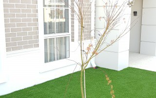 Synthetic Lawn with grass tree in center