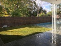 Turf Installation and Frameless Glass Fences in Outdoor Pool Perth