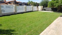 Lawn and Retaining Wall with Fence