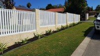 High Limestone Retaining Wall with Fence