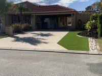 Aggregate Concrete Driveway with Native Plants Garden Design