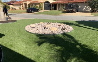 Modern synthetic turf with rock garden design in center
